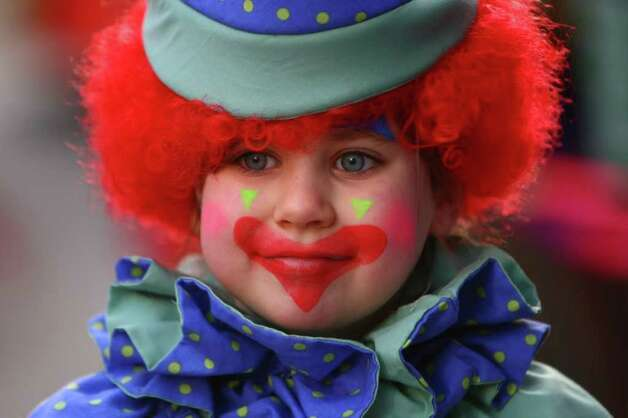 Zoe Wall, 7, is dressed as a clown during the Macy's Holiday Parade on Friday in downtown Seattle. Crowds lined downtown streets to see the annual parade. Photo: JOSHUA TRUJILLO / SEATTLEPI.COM