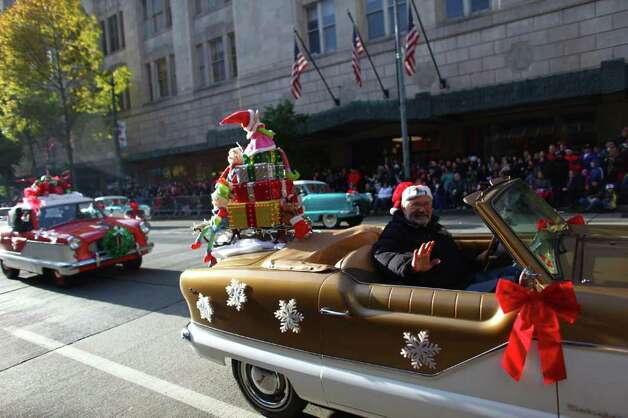 Cars are on display during the Macy's Holiday Parade on Friday in downtown Seattle. Crowds lined downtown streets to see the annual parade. Photo: JOSHUA TRUJILLO / SEATTLEPI.COM