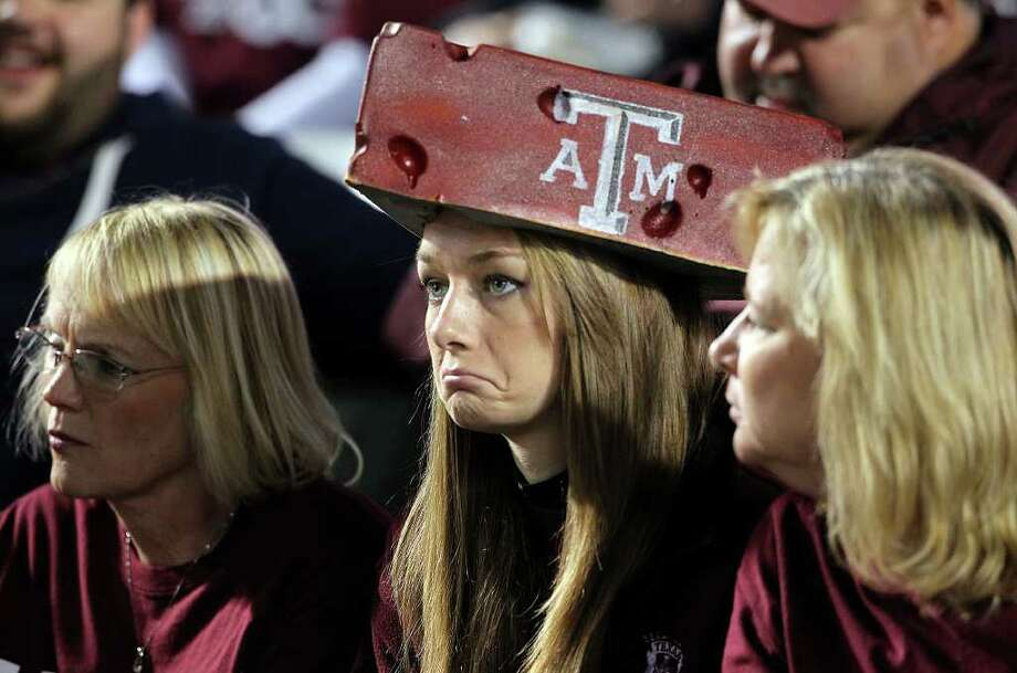 An Aggie fan reacts as Texas A&M hosts UT at Kyle Field in College Station on November 24, 2011. Photo: TOM REEL, SAN ANTONIO EXPRESS-NEWS / © 2011 San Antonio Express-News