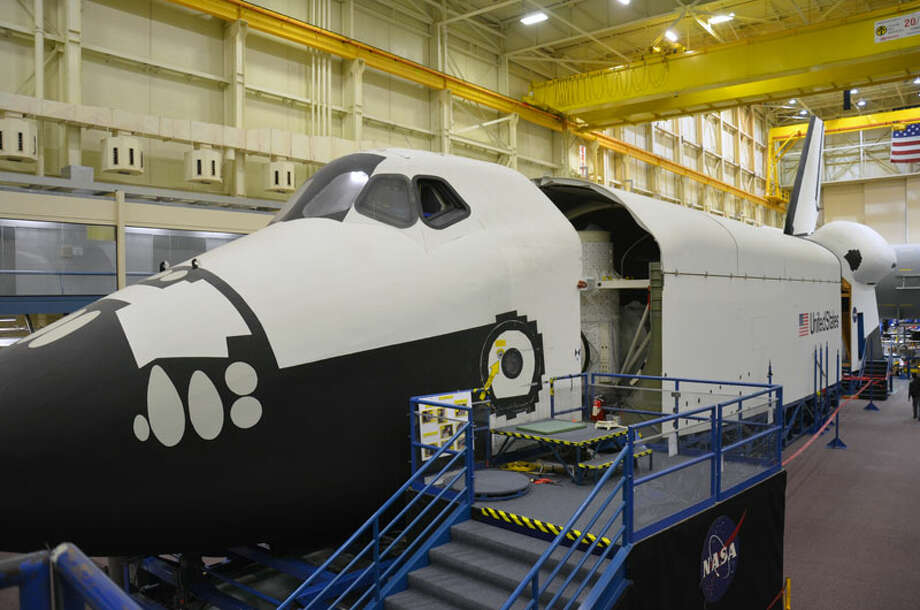 """NASA just started disassembling its full-size space shuttle mockup for shipment next year from Houston's Johnson Space Center to Seattle's Museum of Flight. The Museum of Flight had hoped to win a space shuttle orbiter for its new Space Gallery, set to open next year. But it had to settle for the full-fuselage trainer, which is made mostly of plywood and doesn't have wings, but does include flight-quality systems, including an instrumented crew cabin, payload bay lighting, and closed circuit TV, according to collectSPACE. NASA started by separating the 120-long trainer into three sections, collectSPACE reported. """"Over the next couple of months, workers will remove the aft section's engines and tail so they can be shipped separately, and test hoisting the wooden payload bay off of its metal support base to test its integrity after three decades. The sections will also be weighed to determine if they can be shipped to Seattle using NASA's Super Guppy cargo aircraft."""" Here are more photos of the disassembly, followed by earlier pictures of the trainer. Photo: CollectSPACE/Robert Z. Pearlman"""