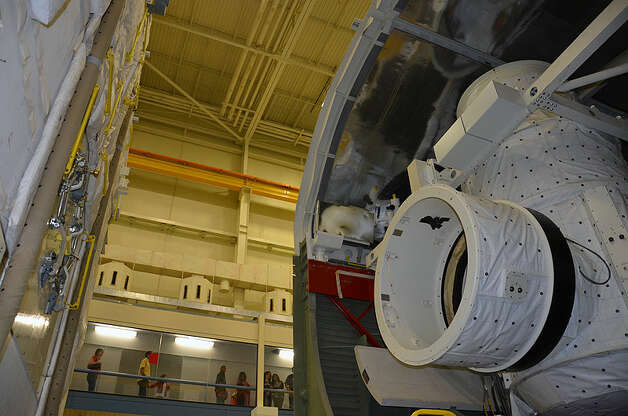 NASA starts disassembling its full-size space shuttle mockup for shipment next year from Houston's Johnson Space Center to Seattle's Museum of Flight. The Museum of Flight had hoped to win a space shuttle orbiter for its new Space Gallery, set to open next year. But it had to settle for the full-fuselage trainer, which is made mostly of plywood and doesn't have wings, but does include flight-quality systems, including an instrumented crew cabin, payload bay lighting, and closed circuit TV. Photo: CollectSPACE/Robert Z. Pearlman