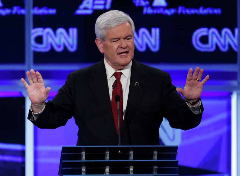 AP Photo UNDER ATTACK: Former House Speaker Newt Gingrich makes a point during Tuesday's debate. Photo: Evan Vucci / AP