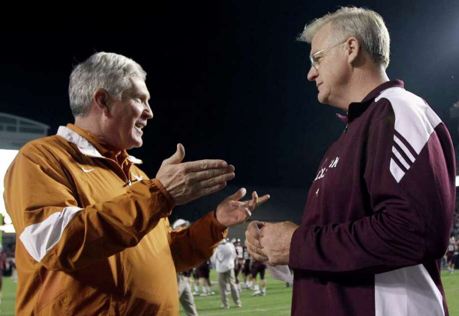 Texas head coach Mack Brown, left, talks with Texas A&M head coach Mike Sherman before an NCAA college football game, Thursday, Nov. 24, 2011, in College Station, Texas. Photo: AP