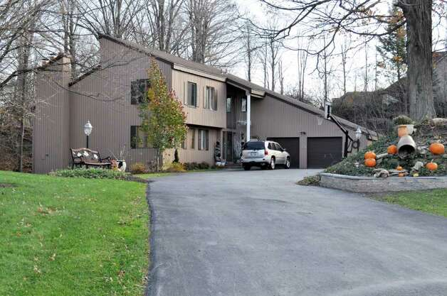 The home of Bernie Fine, Syracuse University men's basketball associate head coach, is shown in DeWitt, N.Y., Friday, Nov. 18, 2011. Fine was placed on administrative leave, Thursday, Nov. 17,  after old child molesting allegations resurfaced. (AP Photo/Kevin Rivoli) Photo: Kevin Rivoli