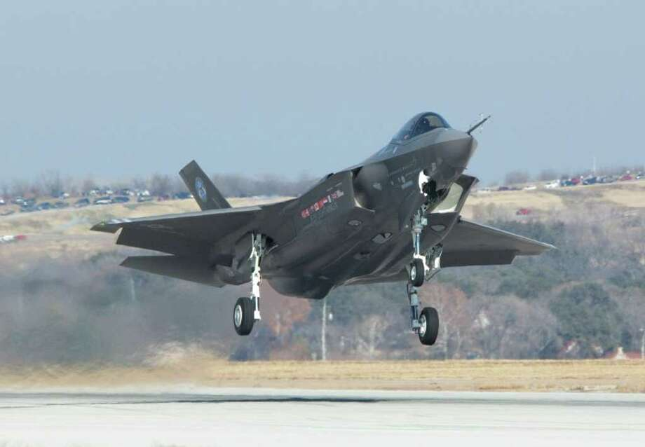 The Joint Strike Fighter is shown taking off on its first flight in Fort Worth five years ago. The Congressional Joint Strike Fighter Caucus has been formed in an attempt to protect funding of the F-35 stealth plane. Photo: COURTESY PHOTO / LOCKHEED MARTIN
