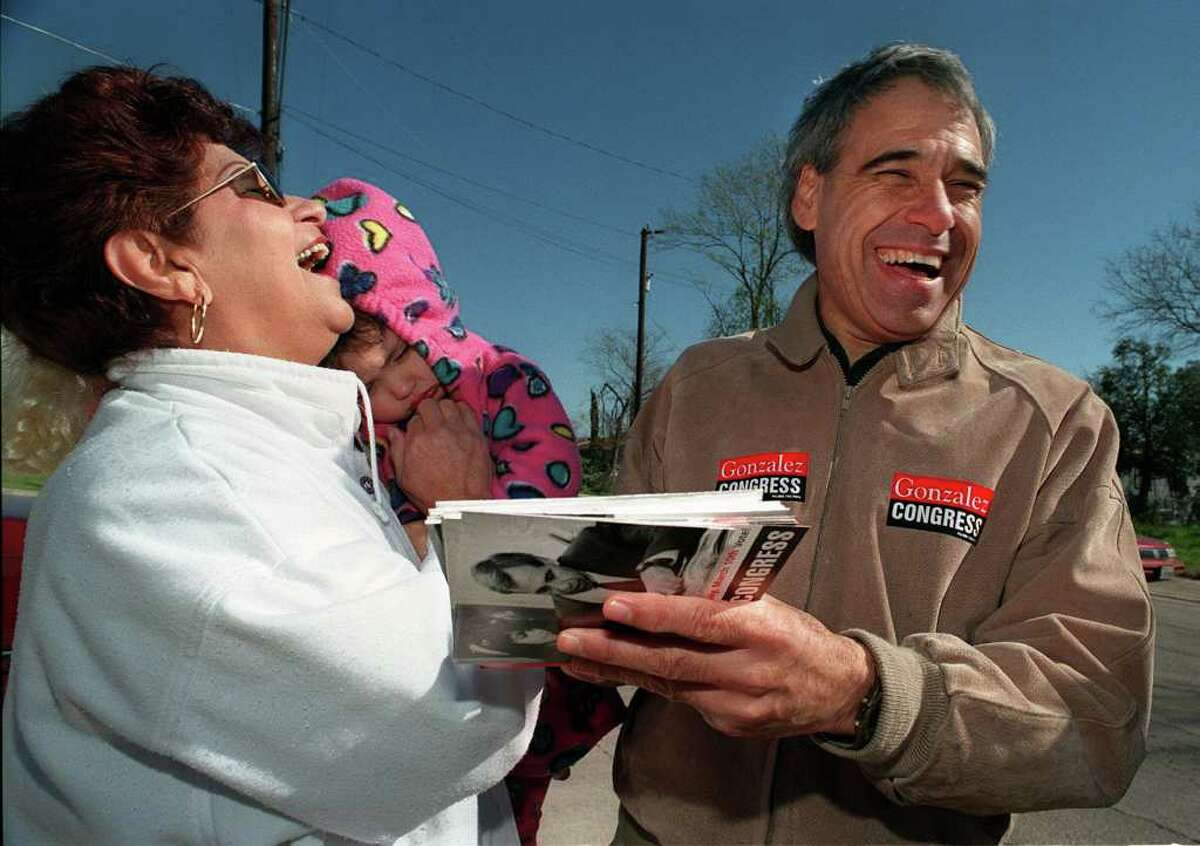 Charlie Gonzalez shares a laugh with Rosie Moran and her 2-year-old granddaughter, Lindsey Dubbles before Moran went in to vote at Holy Family Church in 1998.