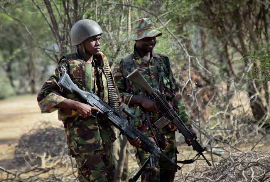 ASSOCIATED PRESS FILES ON BORDER: Kenyan troops are seen near Liboi at the border with Somalia in Kenya. The U.S. has spent more than $500 million since 2007 to try to help stabilize Somalia. Photo: STR / AP