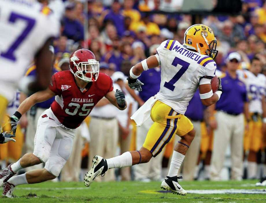 LSU's Tyrann Mathieu (7) returns a punt for a 92-yard for a touchdown during the second quarter of an NCAA college football game against Arkansas in Baton Rouge, La., Friday, Nov. 25, 2011. Photo: AP