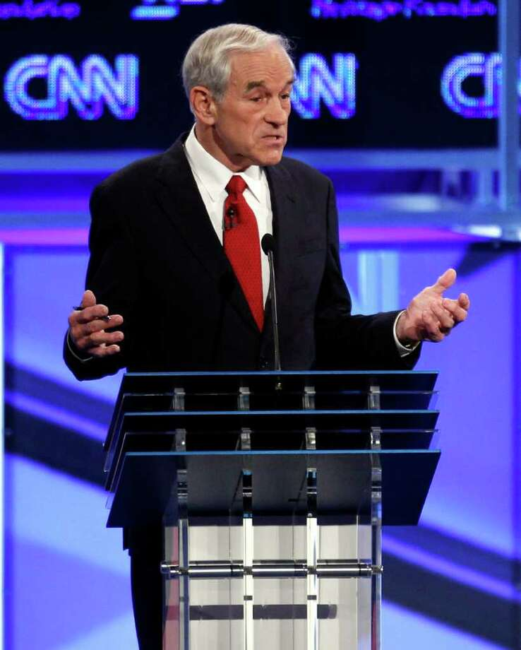 Republican presidential candidate Rep. Ron Paul, R-Texas, speaks at a Republican presidential debate in Washington, Tuesday, Nov. 22, 2011. (AP Photo/Evan Vucci) Photo: Evan Vucci / AP