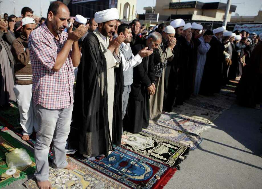 Followers of radical Shiite cleric Muqtada al-Sadr attend Friday prayers in the Sadr City district in Baghdad, Iraq, Friday, Nov. 25, 2011. (AP Photo/Karim Kadim) Photo: Karim Kadim / AP