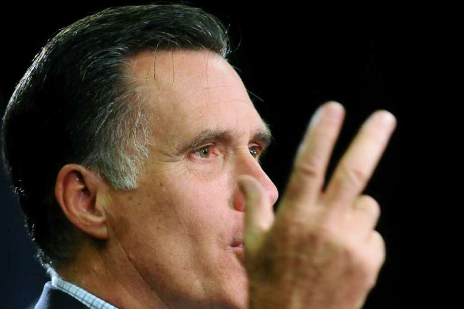 "STEVE POPE : ASSOCIATED PRESS  CULTIVATEd: Former Massachusetts Gov. Mitt Romney's hair ""projects youth,"" says one fan. The GOP hopeful's wife once did the trimming, but now Leon de Magistris does the honors. Photo: Steve Pope / FR59669 AP"