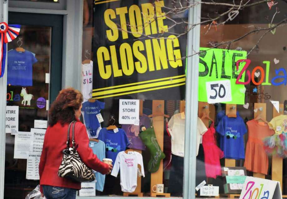 Store closing sign in the window of  Zola Kids shop on Broadway in Saratoga Springs Thursday Nov. 17, 2011. Photo: John Carl D'Annibale / 00015404A