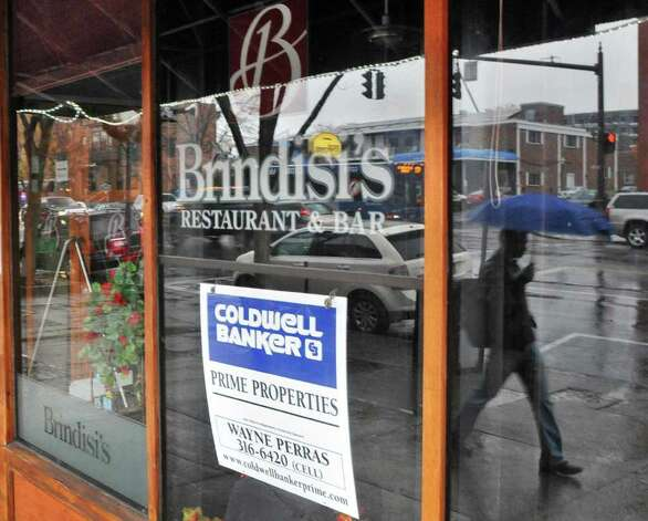 Realtor's sign in the window of the former Brindisi's restaurant on Broadway in Saratoga Springs Wednesday Nov. 16, 2011.   (John Carl D'Annibale / Times Union) Photo: John Carl D'Annibale / 00015404A