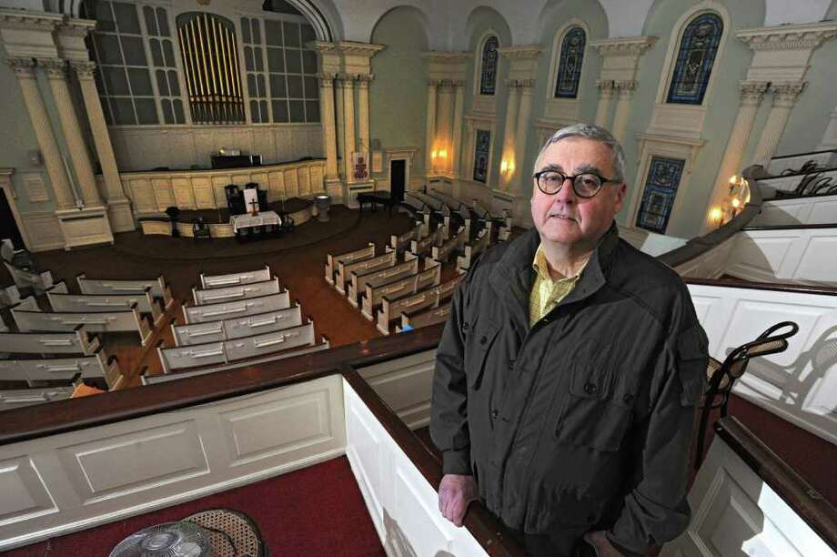 """John """"Jack"""" Waite in the sanctuary of First United Presbyterian Church in Troy, N.Y. Tuesday, Nov. 22, 2011. On Sunday after Thanksgiving and the start of Advent, the congregation will celebrate the first service since the fire in the historic church. (Lori Van Buren / Times Union) Photo: Lori Van Buren"""