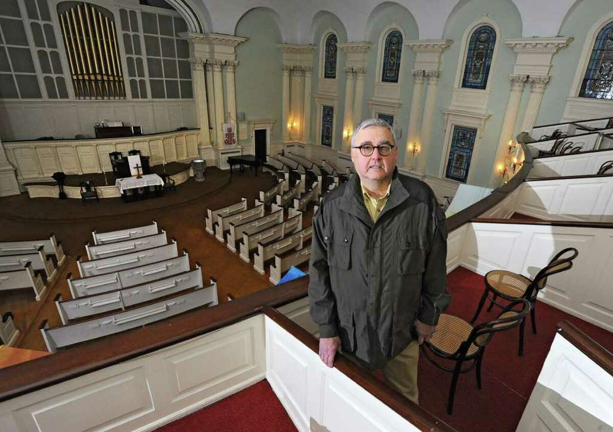 """John """"Jack"""" Waite in the sanctuary of First United Presbyterian Church in Troy, N.Y. Tuesday, Nov. 22, 2011. On Sunday after Thanksgiving and the start of Advent, the congregation will celebrate the first service since the fire in the historic church. (Lori Van Buren / Times Union)"""
