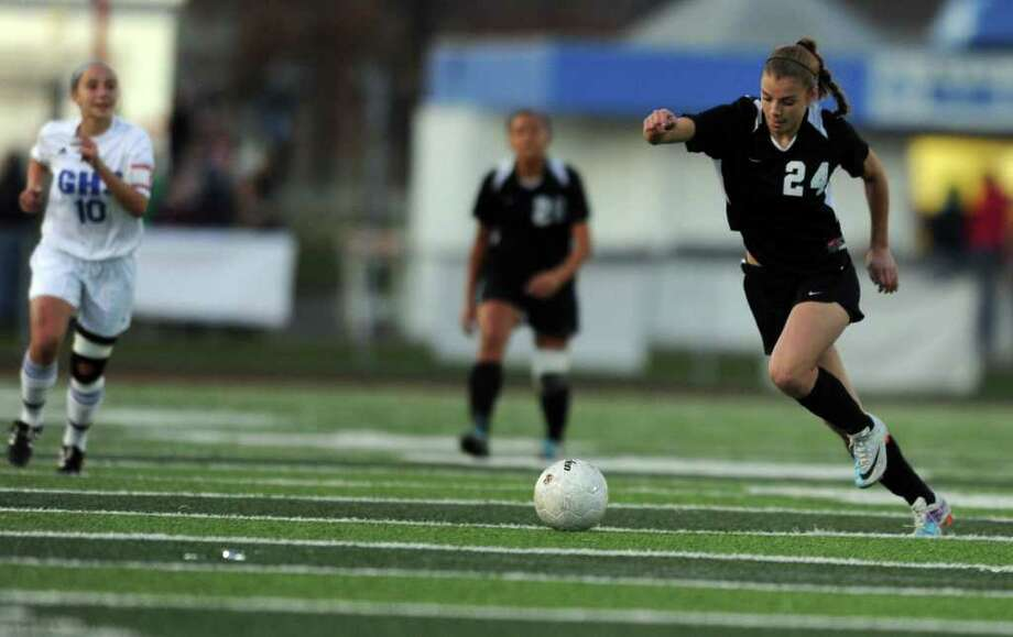 Trumbull's Ana Tantum controls the ball during the Class LL girls soccer state final against Glastonbury Friday, Nov. 25, 2011 at West Haven High School. Photo: Autumn Driscoll / Connecticut Post