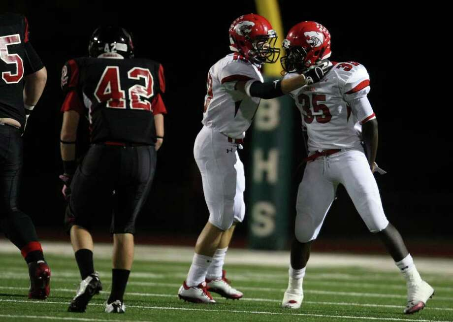 Lorena's Kevin Mottley (35) celebrates a tackle with teammate Kade Robinson during the first half of their 3A Division II Region III semifinal against Coldspring, Friday, November 25, 2011 at Cubs Stadium in Brenham. Photo: Eric Christian Smith, For The Chronicle