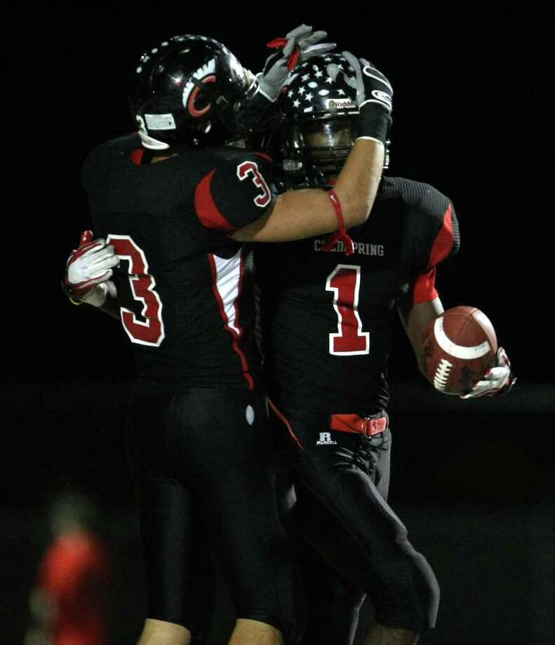 Coldspring's Sherman Gilbert (1) celebrates his 59-yard touchdown with teammate Bryce Shephers during the first half of their 3A Division II Region III semifinal against Lorena, Friday, November 25, 2011 at Cubs Stadium in Brenham. Photo: Eric Christian Smith, For The Chronicle