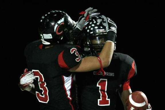 Coldspring's Sherman Gilbert (1) celebrates his 59-yard touchdown with teammate Bryce Shephers during the first half of their 3A Division II Region III semifinal against Lorena, Friday, November 25, 2011 at Cubs Stadium in Brenham.
