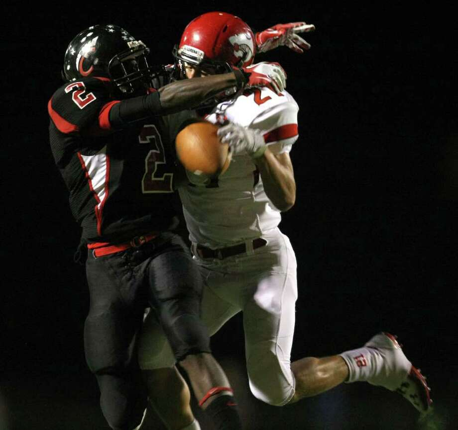 Coldspring's Douglas Johnson (left) breaks up a pass intended for Lorena's Bradly Krall during the first half of their 3A Division II Region III semifinal, Friday, November 25, 2011 at Cubs Stadium in Brenham. Photo: Eric Christian Smith, For The Chronicle