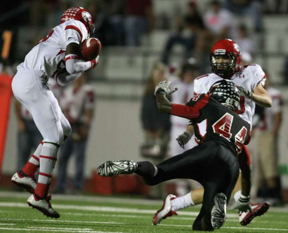 Lorena's Zach Lee (left) intercepts a pass intended for Coldspring's Jonathan Swint (44) during the first half of their 3A Division II Region III semifinal, Friday, November 25, 2011 at Cubs Stadium in Brenham. Photo: Eric Christian Smith, For The Chronicle