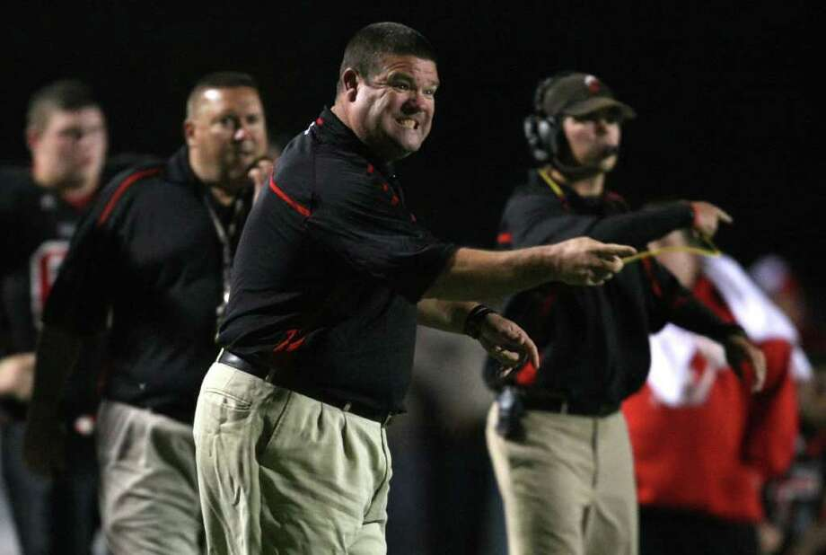 Coldspring defensive coordinator Blake Morrison (center) gives instructions during a goal-line situation for Lorena during the first half of their 3A Division II Region III semifinal, Friday, November 25, 2011 at Cubs Stadium in Brenham. Photo: Eric Christian Smith, For The Chronicle