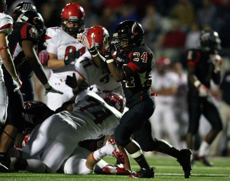Coldspring's Patrick Giddens (24) celebrates a Trojans tackle during the first half of their 3A Divi