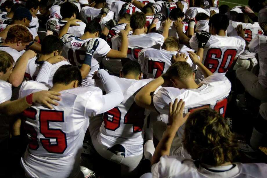 Manvel players huddle in prayer before playing Dayton in a Class 4A Div. II Region III semifinals high school playoff game at Abshier Stadium Friday, Nov. 25, 2011, in Deer Park. Photo: Smiley N. Pool, Houston Chronicle / © 2011  Houston Chronicle