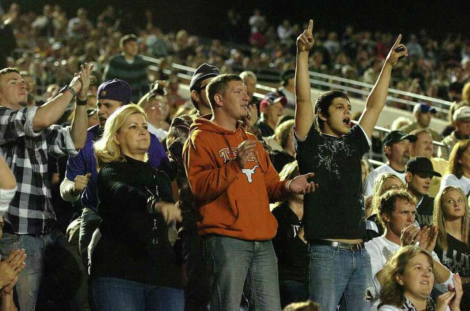 Vidor fans cheer at Galena Park Stadium during the Pirate's match up with the Wildcats Friday night.  Photo: Guiseppe Barranco, Guiseppe Barranco/The Enterprise / The Beaumont Enterprise