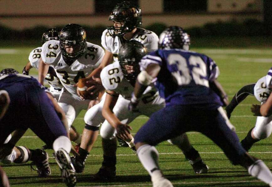 Vidor's Montana Quirante hands off the ball to Brentyn Clark for a short gain against the Wildcats a