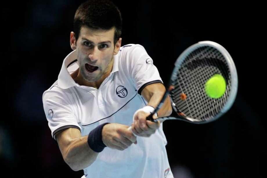 SANG TAN: ASSOCIATED PRESS TOUGH DAY: Novak Djokovic, above, fell to Janko Tipsarevic at the ATP World Tour Finals. Photo: Sang Tan / AP