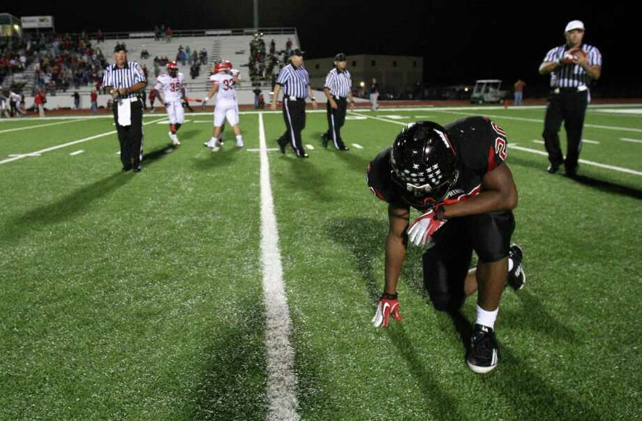 Coldspring's Trey Cooper collects his thoughts after the Trojans' 13-7 victory over the Lorena Leopards in the 3A Division II Region III semifinal, Friday, November 25, 2011 at Cubs Stadium in Brenham. Photo: Eric Christian Smith, For The Chronicle