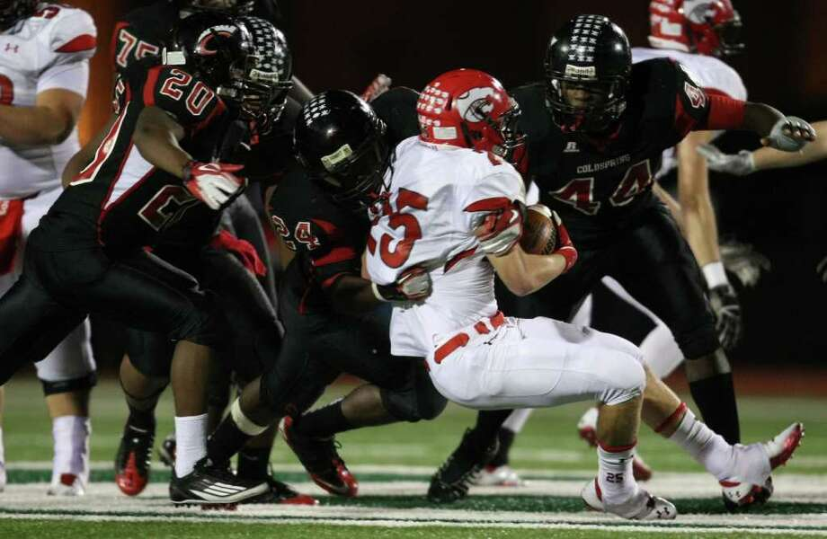 Lorena's Hunter Lowe (25) is brought down for a loss by Coldspring's Patrick Giddens (24) during the second half of their 3A Division II Region III semifinal, Friday, November 25, 2011 at Cubs Stadium in Brenham. Photo: Eric Christian Smith, For The Chronicle