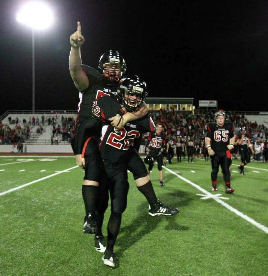 Coldspring's Dillon Matlock (22) carries teammate Chance Andries off the field after their 13-7 victory over the Lorena Leopards in the 3A Division II Region III semifinal, Friday, November 25, 2011 at Cubs Stadium in Brenham. Photo: Eric Christian Smith, For The Chronicle
