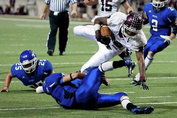 Columbia running back Sean Flannel (22) dives for for a fist down during the Class 3A Division 1 regional semifinals between Columbia and La Vernia November 25, 2011 at the Berry Center in Cypress, Texas. Columbia defeated La Vernia 28-7.