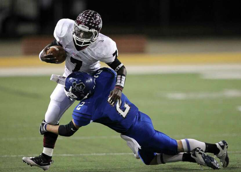 Columbia's Treylon Johnican  (7) is tackled by La Vernia's Kenny Moehrig (2) during the Class 3A Div