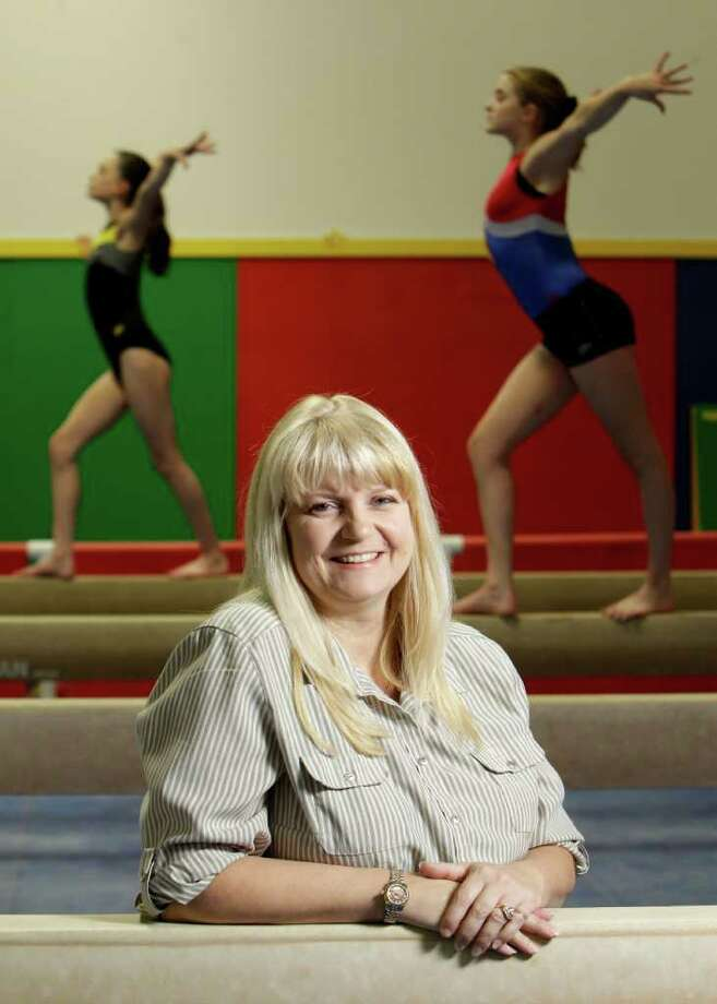 MELISSA PHILLIP : CHRONICLE STRETCHING TO THE WOODLANDS: Lynnis Waldon's Woodlands Gymnastics Academy is actually in Spring. Photo: Melissa Phillip / © 2011 Houston Chronicle