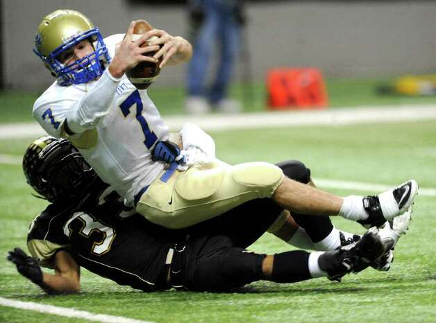 Kerrville Tivy quarterback Parks McNeil (7), reaches for the goal line to score a first-half touchdown as Daniel Brooks of Port Lavaca Calhoun unsuccessfully attempts to stop him during Class 4A Region IV Division II playoff action at the Alamodome on Friday, Nov. 25 2011. BILLY CALZADA / gcalzada@express-news.net   Kerrville Tivy vs. Port Lavaca Calhoun Photo: BILLY CALZADA, Express-News / gcalzada@express-news.net