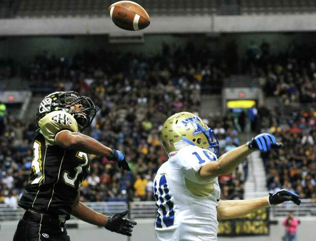 Daniel Brooks of Port Lavaca Calhoun, left, intercepts a ball that was tipped by receiver Kason Fornes of Kerrville Tivy during Class 4A Region IV Division II playoff action at the Alamodome on Friday, Nov. 25 2011. The interception led to a Calhoun touchdown on the very next play. BILLY CALZADA / gcalzada@express-news.net   Kerrville Tivy vs. Port Lavaca Calhoun Photo: BILLY CALZADA, Express-News / gcalzada@express-news.net