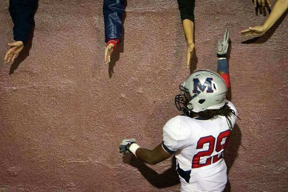 Manvel running back Selwyn Green (29) celebrates with fans following the Mavericks 49-10 victory over Dayton in Class 4A Div. II Region III semifinals high school playoff action at Abshier Stadium Friday, Nov. 25, 2011, in Deer Park. Photo: Smiley N. Pool, Houston Chronicle / © 2011  Houston Chronicle