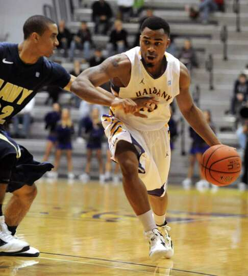 Mike Black of UAlbany drives to the basket during a basketball game against Navy at SEFCU Arena in A
