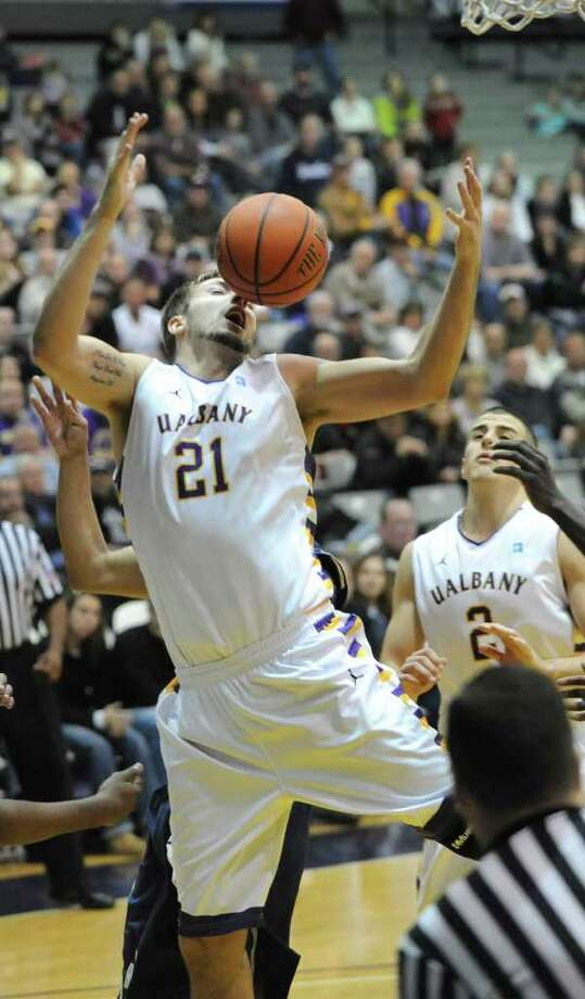 Blake Metcalf of UAlbany is fouled while trying to get a rebound during a basketball game against Navy at SEFCU Arena in Albany, N.Y. Friday, Nov. 25, 2011. (Lori Van Buren / Times Union) Photo: Lori Van Buren