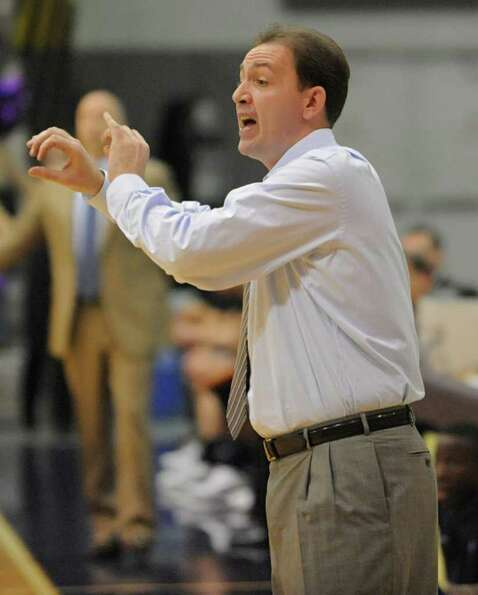 UAlbany coach Will Brown yells from the sideline during a basketball game against Navy at SEFCU Aren