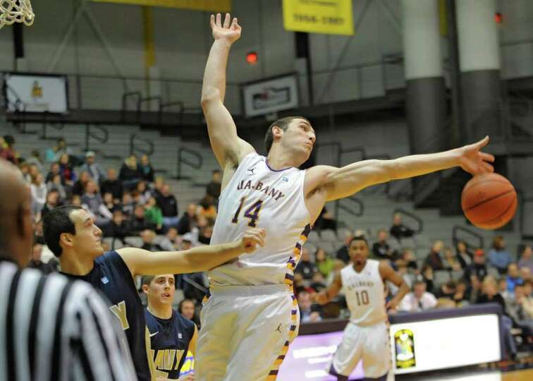 UAlbany's Sam Rowley tries to get a rebound during a basketball game against Navy at SEFCU Arena in