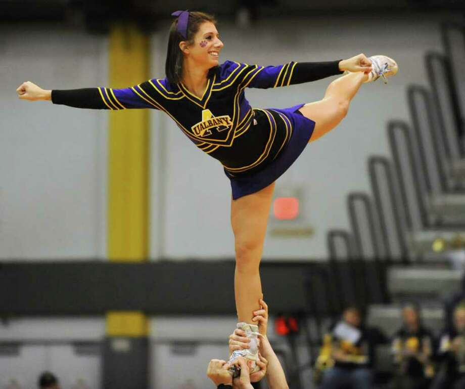 A UAlbany cheerleader is held in the air during a basketball game against Navy at SEFCU Arena in Albany, N.Y. Friday, Nov. 25, 2011. (Lori Van Buren / Times Union) Photo: Lori Van Buren