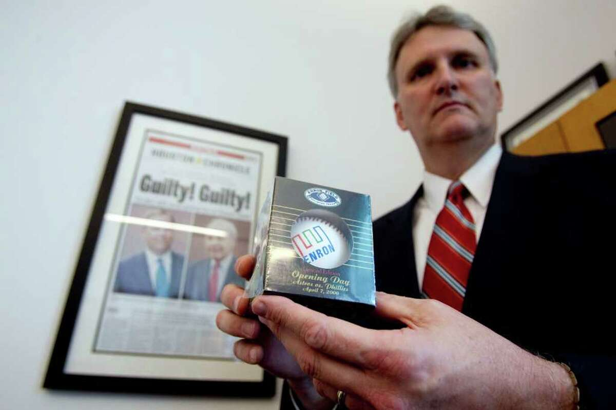Mike Anderson, FBI assistant special agent in charge of the white-collar crime unit in Houston, shows his Enron baseball, one of his many pieces of Enron memorabilia.