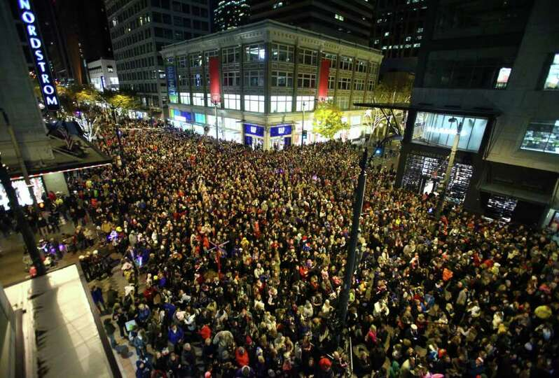 People Watch The Festivities During The Westlake Center