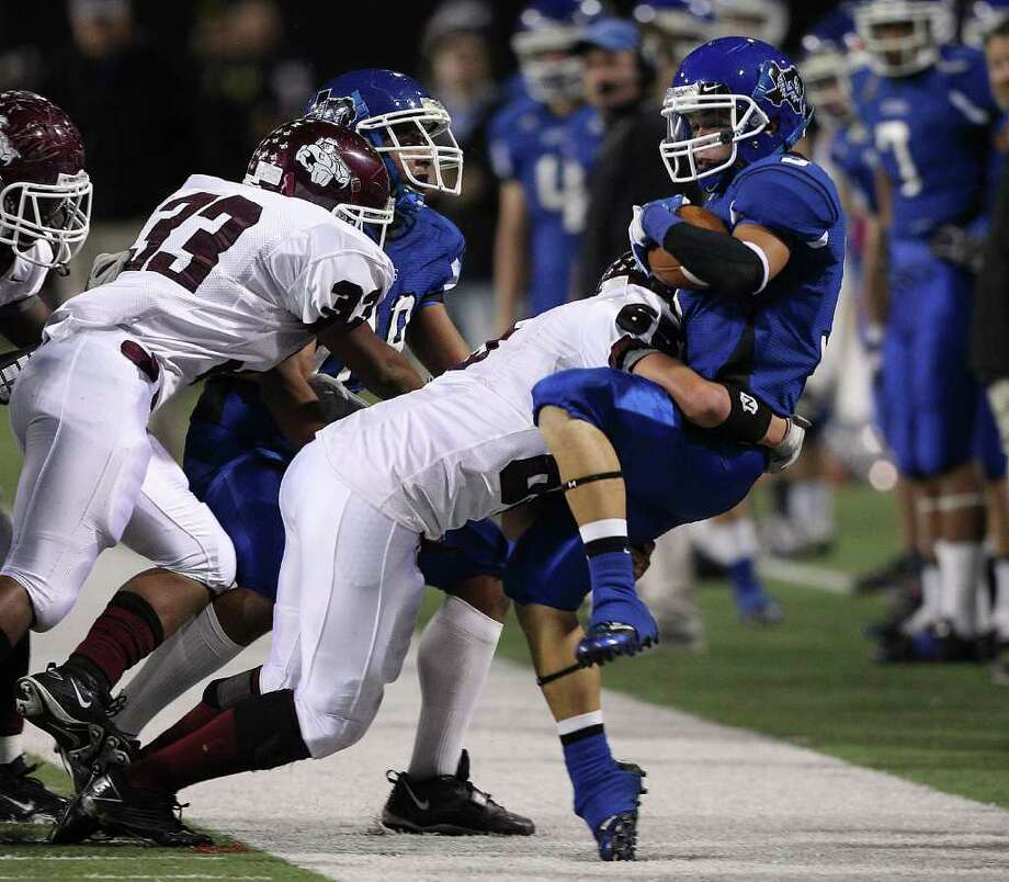 BOB LEVEY: FOR THE CHRONICLE TAKEN OUT: La Vernia's Josh Rutledge, right, is driven out of bounds by Columbia defender Danny Hunt on Friday night at the Berry Center. Photo: Bob Levey / ©2011 Bob Levey