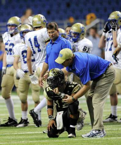 Kerrville Tivy athletic director Mark Smith comforts Port Lavaca Calhoun quarterback Joseph Bargas after Tivy defeated Calhoun, 50-43 in Class 4A Region IV Division II playoff action at the Alamodome on Friday, Nov. 25 2011. BILLY CALZADA / gcalzada@express-news.net   Kerrville Tivy vs. Port Lavaca Calhoun Photo: BILLY CALZADA, Express-News / gcalzada@express-news.net