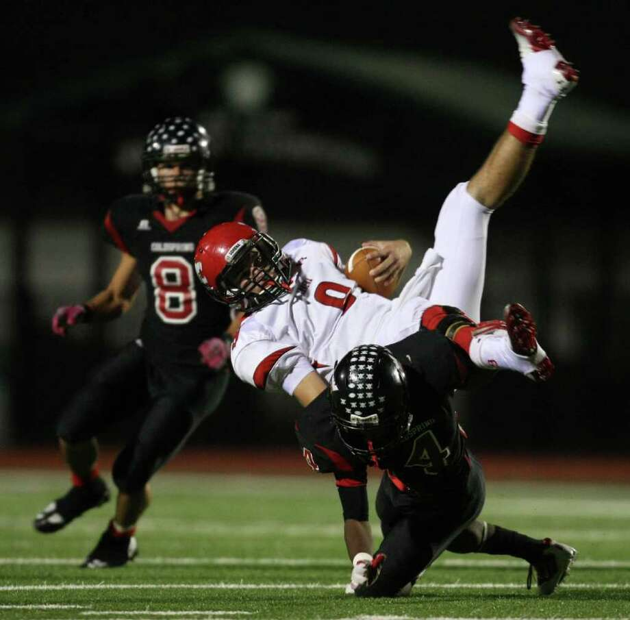 ERIC CHRISTIAN SMITH: FOR THE CHRONICLE UPENDED: Lorena's Fisher Simpson, center, is taken down by Coldspring defender Jerrell Sykes during the first half Friday night at Cubs Stadium in Brenham. Photo: Eric Christian Smith